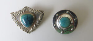 A. E. Jones brooches with Ruskin enamels.