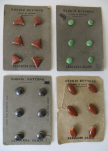 Ruskin buttons on factory cards.