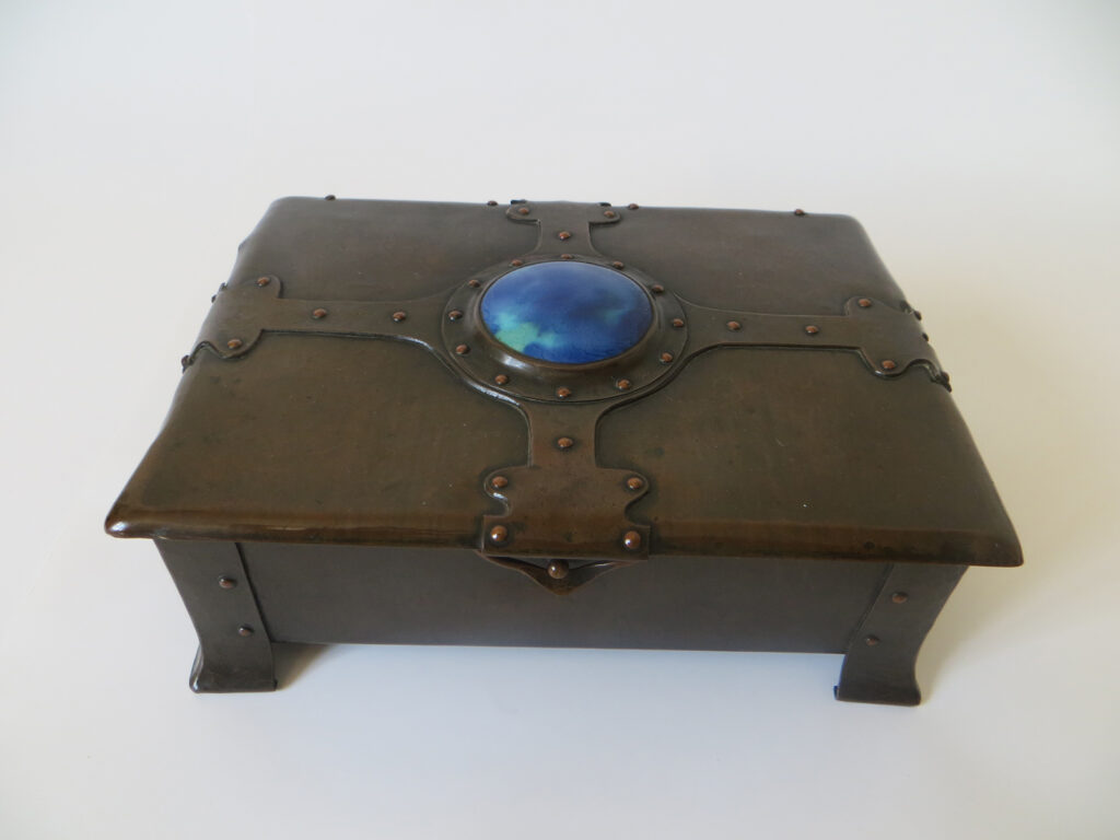 A. E. Jones copper casket with Ruskin enamel.