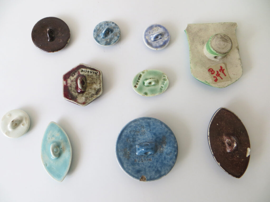Ruskin enamel buttons, various shapes.