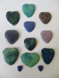 Early Ruskin heart enamels, unmounted.