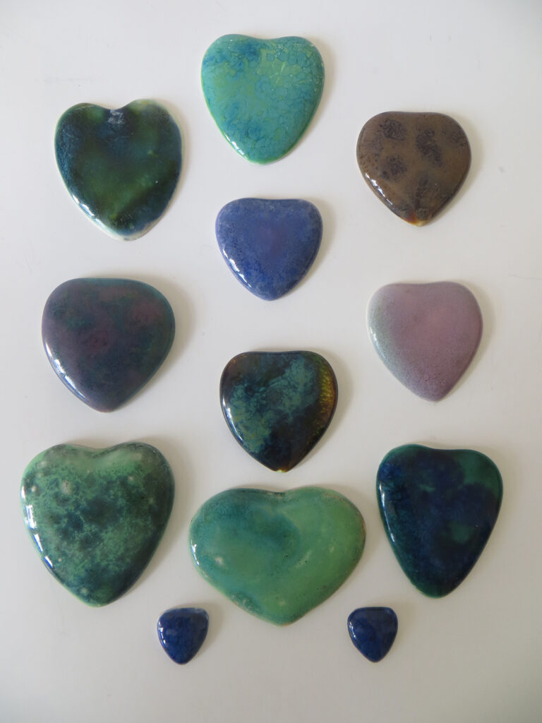 Early Ruskin heart enamels, unmounted.