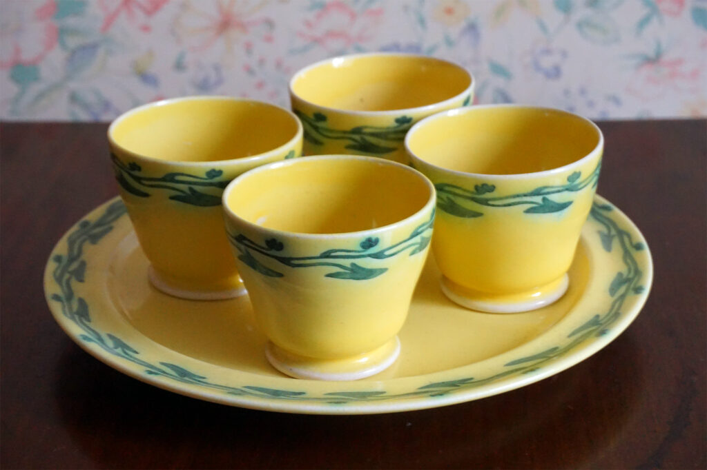 Early egg cups in a soufflé yellow glaze.