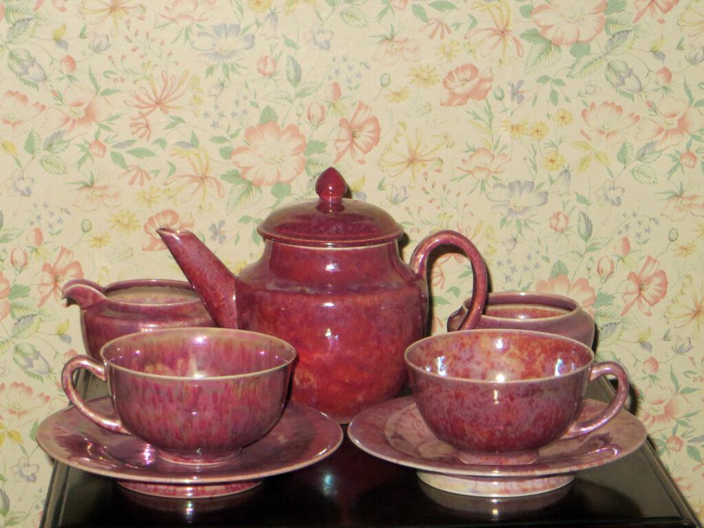 Tea set in pink lustre glaze.