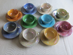 1920s Ruskin cups and saucers in the harlequin glazes.