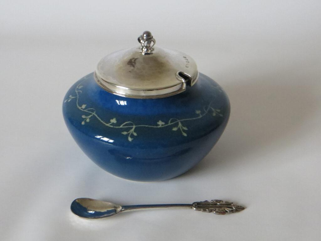 1921 Ruskin jam pot in the popular 'Chrome 11' glaze with A. E. Jones mounts.