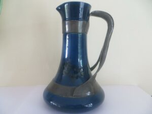 Ruskin pottery jug with strap-work by Jesson and Birkett circa 1904/5, scissor mark to base.