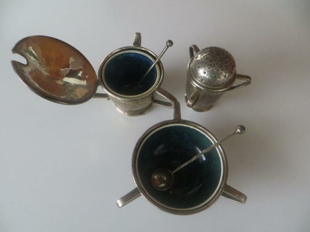 A. E. Jones cruet set with Ruskin liners.